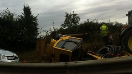 A digger fell off a trailer onto the A14 yesterday.