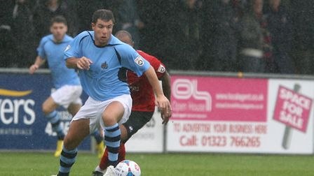 John Frendo in action against Eastbourne in the rain. Picture: Leigh Page