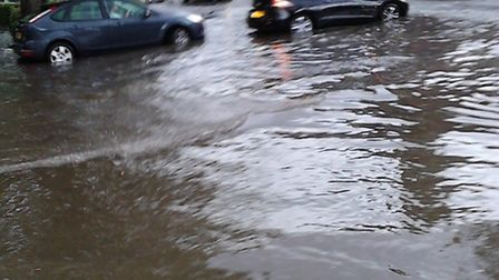 Bower's Parade flooded near the junction of Harpenden high street - photo Teresa Walshe