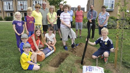 Local pupils, residents, and community groups, burying a timecapsule to commemorate 1914 on Samuel J