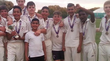 Rony, second from right, was part of a cup win with Huntingdon and District Cricket Club.
