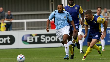 James Comley in a chase for the ball. Picture: Leigh Page