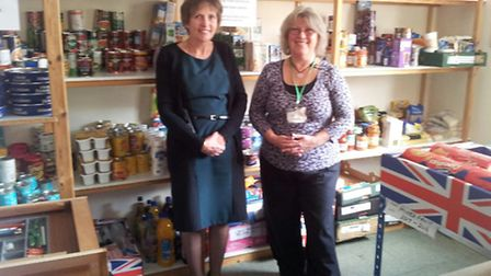 Jessica Kerr and Viv Williams at the foodbank storage centre