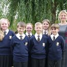Regina Lawrence with Melbourn Village College students modeling their new uniform