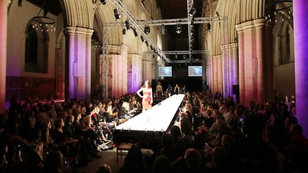 Models walk the longest indoor catwalk in the UK in St Albans Abbey for the St Albans Fashion Show