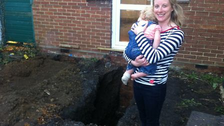 Claire Wheeler with daughter Jessie next to the area where the bones were found.