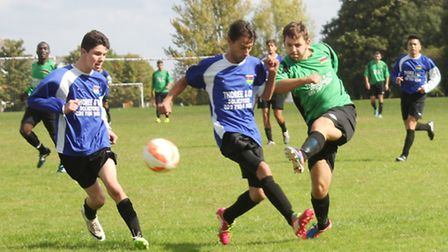 A Garston forward takes on two Herts Mauritian defenders.