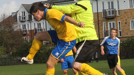 Colin Hagger, St Albans Royals' keeper, punches clear against Blacksmiths Arms.
