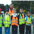 Cub Scout Leader Chris Grandy with members of the hiking team