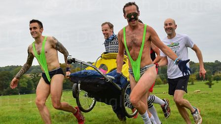 Paul Makowski (right), dressed as Borat, pushing a cycle buggy carrying the race director, Richard