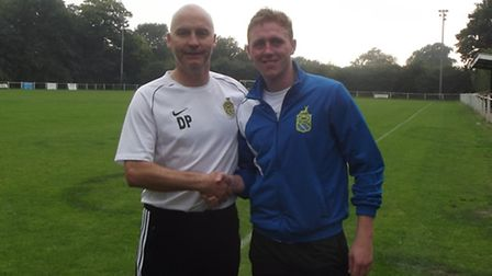 Harpenden Town manager Danny Plumb congratulates Nick Elliot for winning August player of the month.