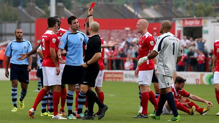 Referee Constantine Hatzadakis shows the red card to David Keenleyside following his second booking