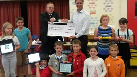 Robert Dunbar, head teacher at St Mary's, receives a cheque from James Yarrow, Friends of St Mary's