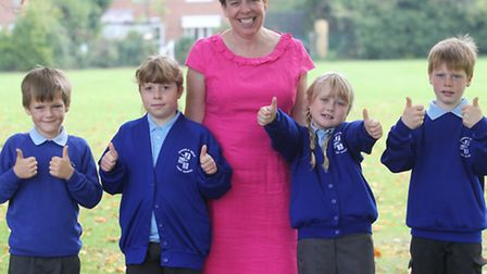 Icknield Walk First School pupils, pictured with headteacher Jane Sherwood, give the thumbs up to th