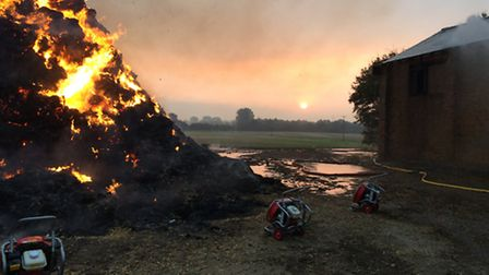 The smouldering heap of straw after arsonists struck in Brampton. Picture: CAMBS FIRE AND RESCUE SER