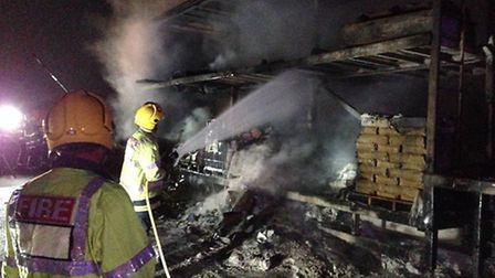 Firefighters extinguishing the lorry blaze. Picture: Cambs Fire and Rescue Service.