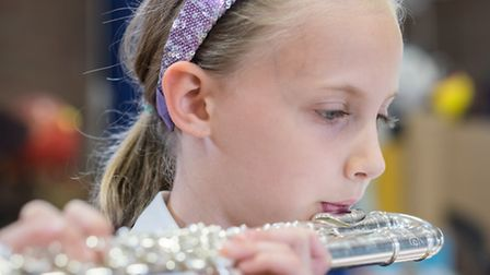 Tannery Drift school pupil Willow Wilson playing the flute at a recent concert. The school has just