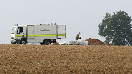 Bomb disposal officers set up the controlled explosion