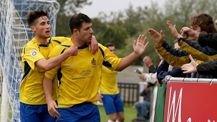 John Frendo celebrates with the travelling Saints fans following his opening goal. Picture: Leigh Pa
