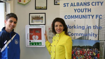 Cllr Annie Brewster and George Calverley.with St Albans City Youth's new defibrillator.