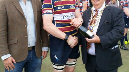 St Albans mayor Geoff Harrison presents Don Barrell with the man of the match award.