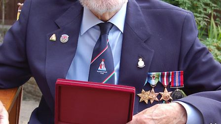 Arctic Convoy veteran Norman Alvey, of Harpenden, with his recently presented Ushakov medal. Photo c