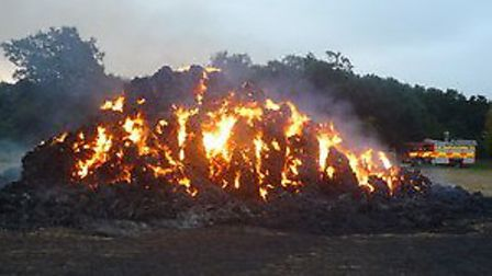 A burning stack of straw in Wennington. Picture: CAMBS FIRE AND RESCUE SERVICE.