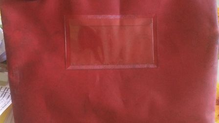 Police have released an image of a wallet identical to that used by burglars in a Bassingbourn raid