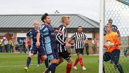 Lewis Hilliard sees a header go close. Picture: Claire Howes