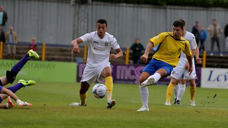 John Frendo slots home the Saints' second goal against Sutton. Picture: Leigh Page