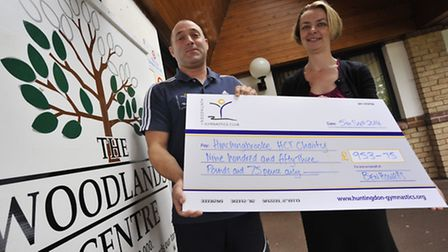 Ben Howells presents a cheque for £953.75 to Woodlands oncologist Dr Cheryl Palmer.