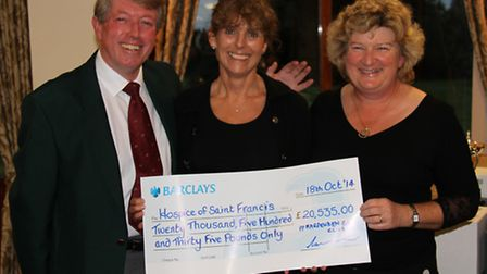 Club captains David Oxley and Liz Salvesen present Sarah Ajder, of Hospice of St Francis, with a che