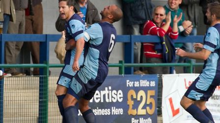 Gavin Hoyte lifts goalscorer Drew Roberts. Picture: Claire Howes