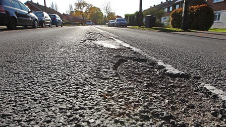 Damaged road surface on Drakes Drive