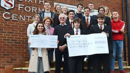 Pupils at Beaumont School hand over cheques totalling almost £5,000 to the Prince's Trust