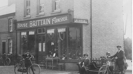 The Eaton Ford shop in 1908, with Frank and his wife Alice and Archie.