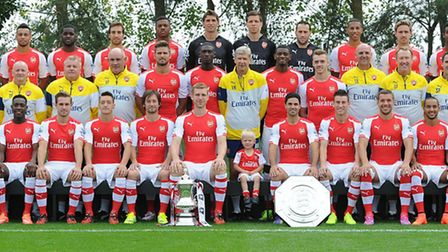 Junior Gunner competition winner Jack Pike, centre, attends the Arsenal 1st Team squad photoshoot at
