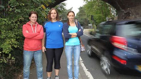 Local mums Nicola Wallace, Annelize Fagan and Johanne Jorge stand on the narrow pavement which is pa