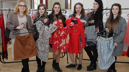 Volunteers help out in a swap shop in the town hall in the build up to Fashion Week