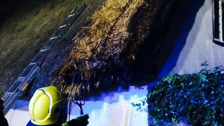 Firefighters tackle a fire on the roof of an Offord Cluny property.