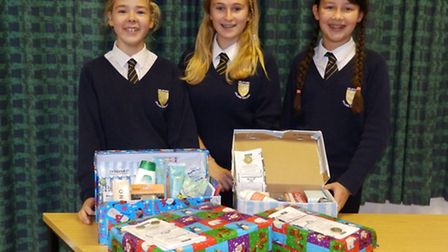 (left to right) Morgan Want, Mia Flowerdew and Ellie Clark with the first of the donated shoeboxes.