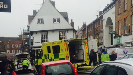 A woman has been taken to hospital following a suspected seizure