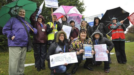 Hinchingbrooke Hospital picket line, midwifes and nurses holding their plaquards.
