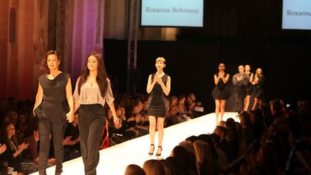 Student designer Roxanna Behrouzi walks the catwalk with models wearing her creations - photo Craig