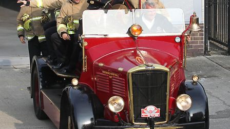 Members of green watch with watch commander Tony Bates take a ride on an old fire truck from the 195