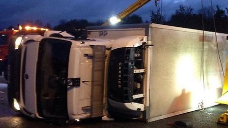 The overturned lorry on the A1(M) near Sawtry. Picture: BCH ROAD POLICING