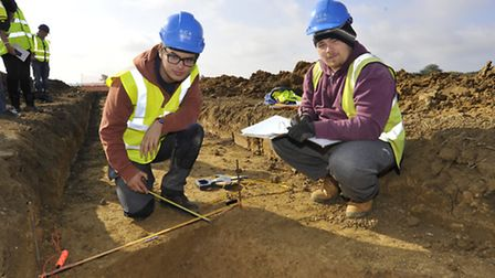 Archaeology dig at Brampton Services, (l-r) Archaeologists Sam Corke, and Tom Learmonth, from PCA Ca