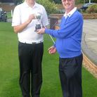 Royston Golf Club's junior captain Sam Chipperfield receiving the Vernon Putting Trophy from club ca