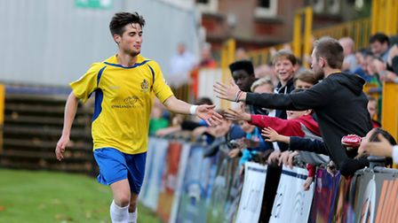 Sean Shields celebrates with Saints fans after scoring the second goal of the game