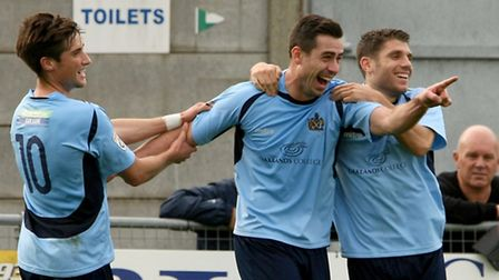 The smile on Steve Wales' face is large after putting the Saints two up. Picture: Leigh Page